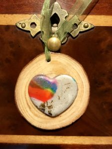 multi-colored heart on round wood block